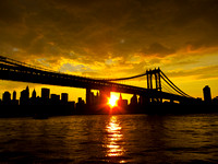 Yellow sunset on the East River, Manhattan Bridge front and center.